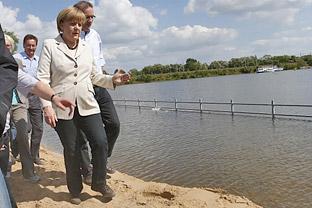 Germany Angela Merkel floods